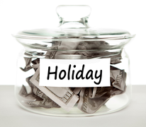 "Clear Jar filled with cash labeled ""Holiday"""