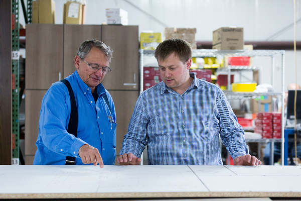 Phil Cohen (left), CEO of Cohen Architectural Woodworking, works on a project with his son, COO Ben Cohen. The company sustains its unique culture by hiring people who fit into the work environment, rather than bringing in employees with the flashiest resumes.