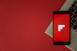 Flipboard logo on phone screen