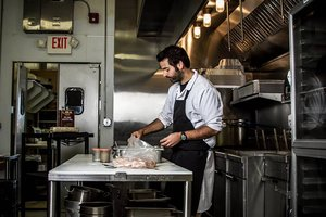 Catullo owner in kitchen, holiday food shipping