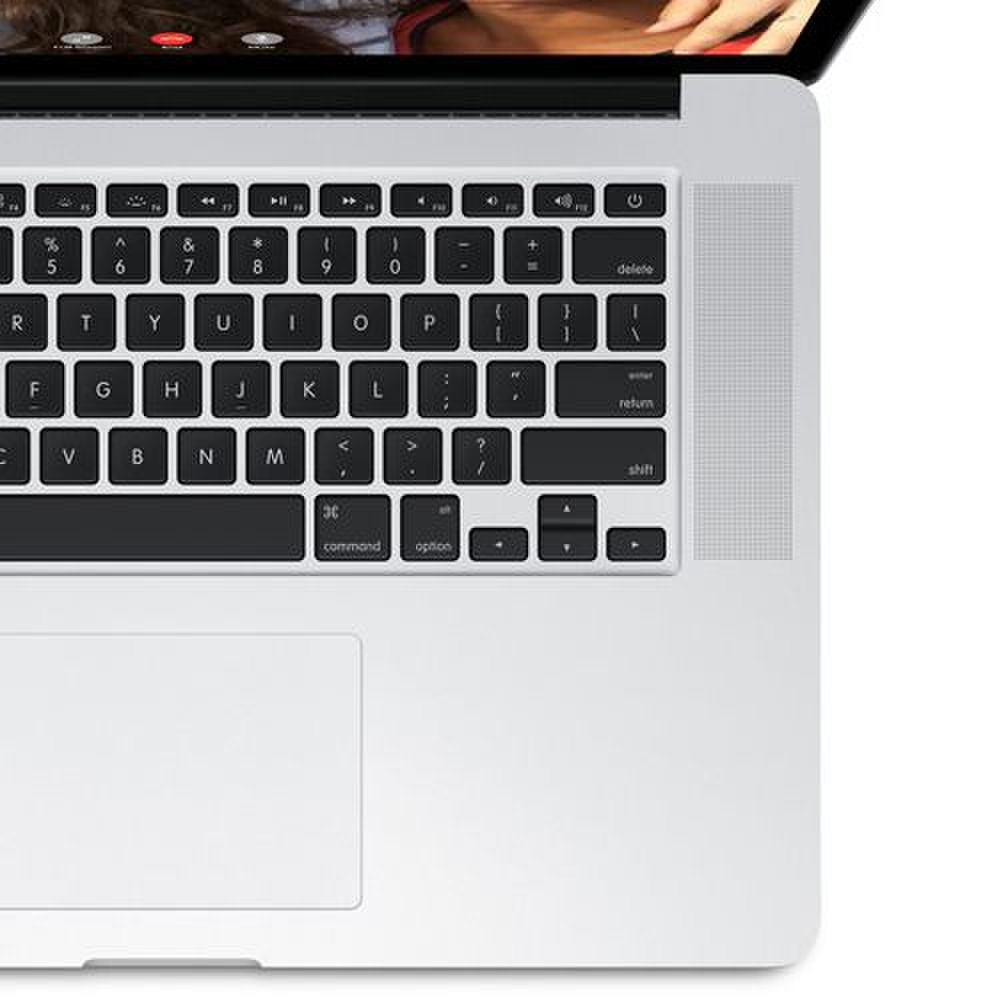 Apple MacBook Pro 15 image: The keyboard has black, chiclet-style keys with backlighting. There are also stereo speakers on either side of the keyboard and a pressure-sensitive Force Touch touchpad.