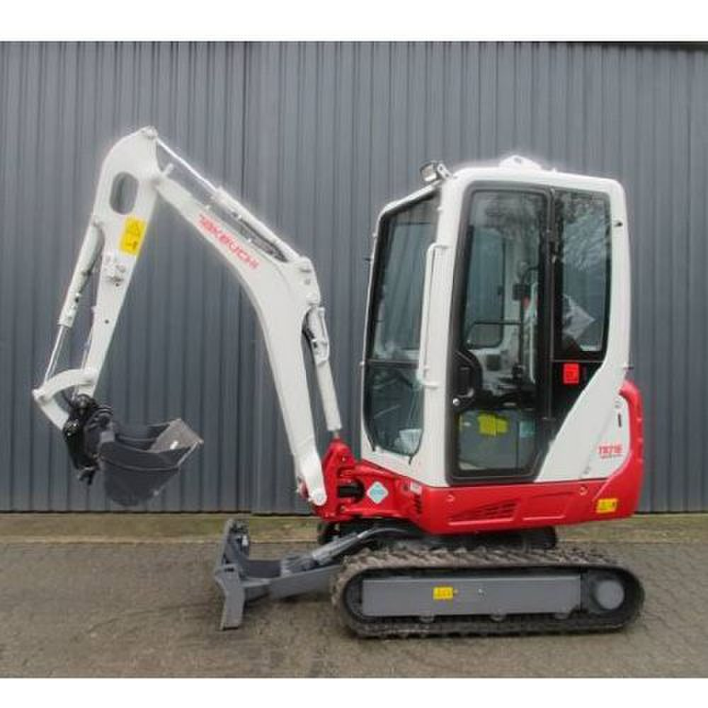 Takeuchi TB216 Compact image: This excavator applies a ground pressure of 4.3 pounds per square inch.