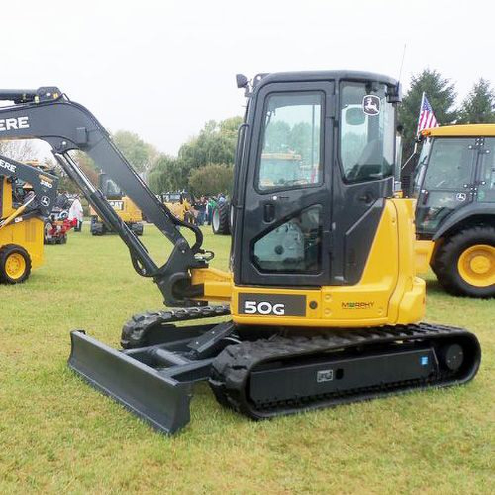 John Deere 50G Compact image: There are steel tracks padded with rubber that help with rough terrain.