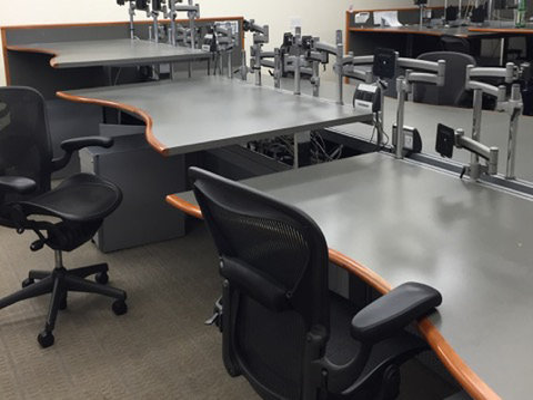 Photo of empty ergonomic chairs and desks